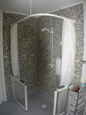 Corner Shower with Double Curtains and Mosaic Tiling